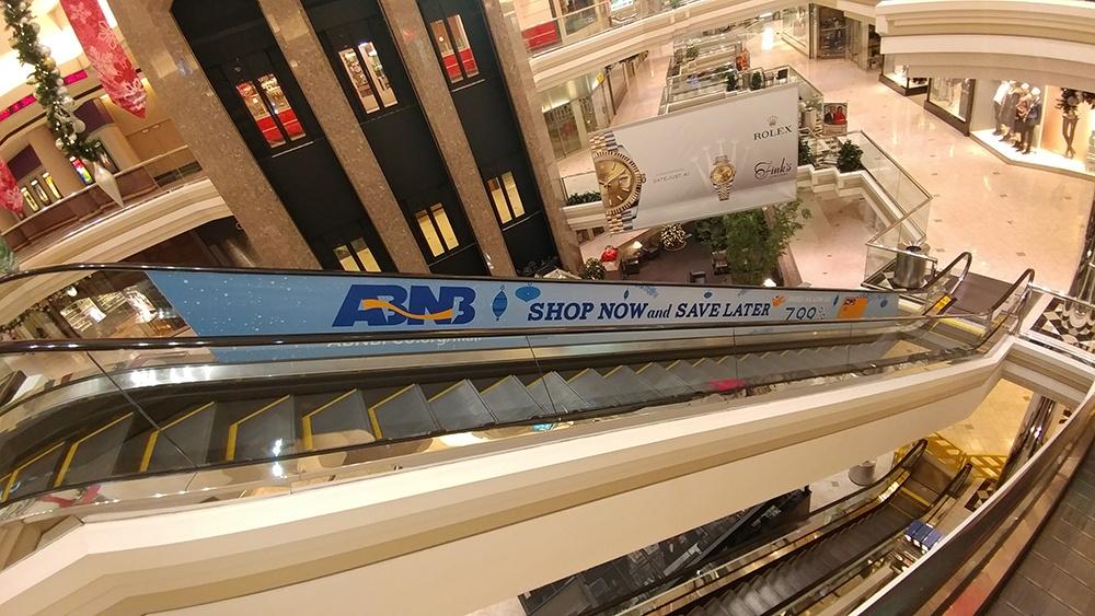 ABNB escalator wrap
